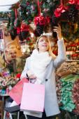 Girl shopping at festive fair — Stock Photo