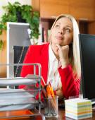 Businesswoman sitting at office desk — Stock Photo