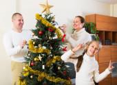 Smiling family preparing for Christmas — Stock Photo