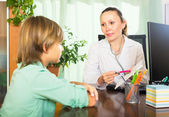 Doctor with teenage patient — Stock Photo