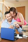 Couple with new digital camera — Stock Photo