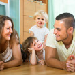 Happy family of four at home — Stock Photo #64338843