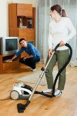 Happy couple doing housework together — Stock Photo