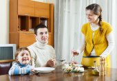 Family having lunch at home — Stock Photo