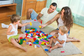 Family at home with toys — Stock Photo
