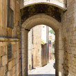 Arch over old narrow street of Girona — Stock Photo #66548345