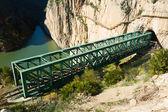 Railway bridge in rocky mountains — Стоковое фото