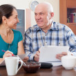 Happy senior couple holding  documents — Stock Photo #66552995