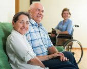 Parents and daughter in wheelchair — Stock Photo