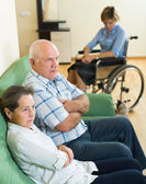 Mature couple and disabled woman indoor — Stock Photo