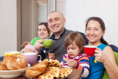 Family having tea at home — Photo