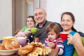 Family having tea at home — Стоковое фото