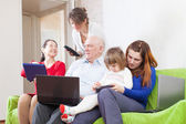 Family with portable computers — Stock Photo