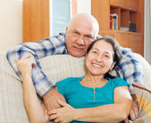 Elderly man flirting with mature girlfriend  — Stock Photo