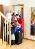Family seeing off relatives — Stock Photo