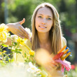 Female florist working in garden — Stock Photo #66583973