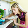 Maid cleans modern stove — Stock Photo #66584477