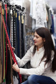 Woman  chooses  belt at shop — Stock Photo