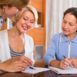 Female pensioners with public notary — Stock Photo #66599439