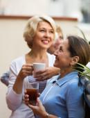 Female friends on summer terrace — Stock Photo