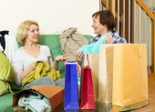 Women  talking about purchases — Stock Photo