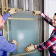 Two workers working with glass — Stock Photo #66604489