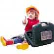 Sitting child in hardhat with tools — Stock Photo #66608479