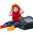 Smiling child in builder hardhat with tools — Stock Photo #66608503