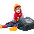 Serious child in hardhat with working tools — Stock Photo #66608531