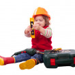 Child in builder hardhat with tools — Stock Photo #66608547