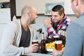 Friends armwrestling at table — Stock Photo