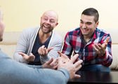Guys sitting at table — Stock Photo