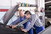 People  working at carshop — Stock Photo
