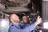 Two men fixing car — Stock Photo