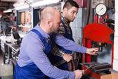 Mechanics working at workshop — Stock Photo