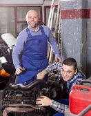 Mounting specialists in coveralls working — Stock Photo