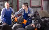 Specialists working with motocycles — Stock Photo