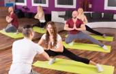 Adults having group fitness class — Stockfoto
