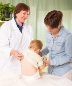 Friendly pediatrician doctor examining baby — Stock Photo