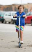 4 years old girl with scooter — Stock Photo