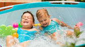 Children swimming in kid pool — Stock Photo
