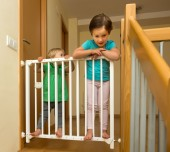 Two  girls approaching safety gate — Stock Photo