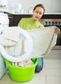 Sad woman near washing machine — Stock Photo