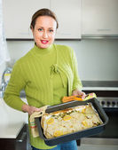 Housewife cooking filleted fish — Stock Photo