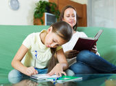 Mother with little daughter  doing homework   — Foto Stock