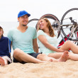 Happy parents with kid on beach — Stock Photo #66638253