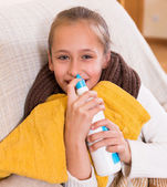 Little girl treating for rhinitis — Stock Photo