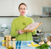Housewife cooking fish soup — Stock Photo