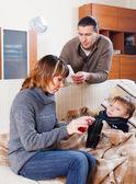 Parents giving liquid medicament to son — Stock Photo