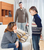 Parents scolding  son in home — Stock Photo